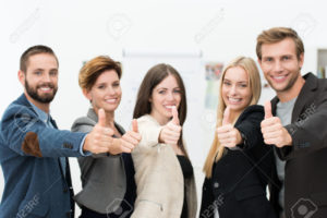 23297694-motivated-successful-business-team-of-diverse-young-professionals-giving-a-thumbs-up-to-show-their-a-stock-photo
